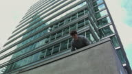 MS LA Man doing handstand on building ledge, performing parkour, Vancouver, British Columbia, Canada