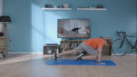 Man doing his workout at home