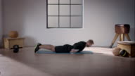 Man doing his workout in gym (swimmer stretched arms)