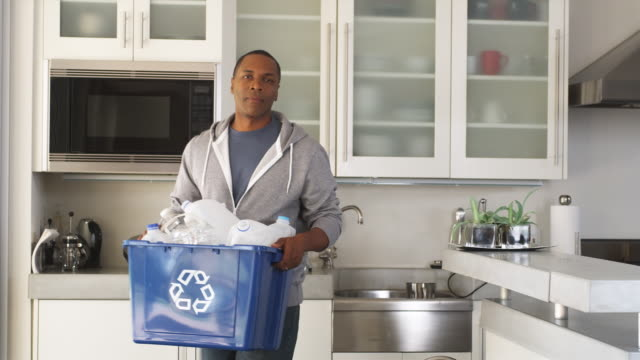 MS Man doing recycling around home, Phoenix, Arizona, USA