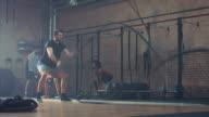 Man doing tough workout with ropes
