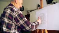 Man draws Self Portrait