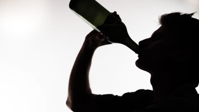 HD: Man Drinking From Wine Bottle