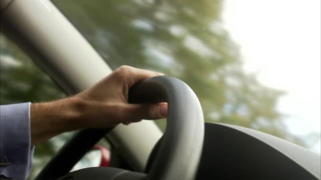 A man driving a car Sweden.