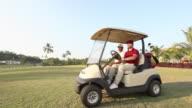 Man driving a golf cart