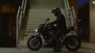 Man driving a motorcycle at night