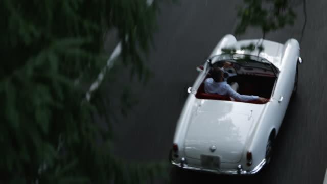 Man driving cabriolet