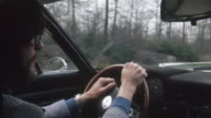 1978 MONTAGE POV CU MS Man driving car on country highway, New Jersey, USA