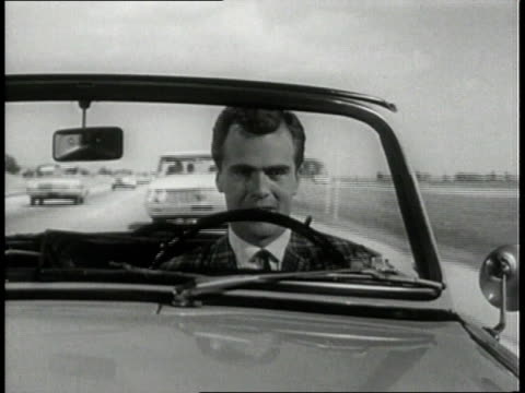 1963 MONTAGE Man driving car, speeding and weaving in-and-out of traffic on highway / United States