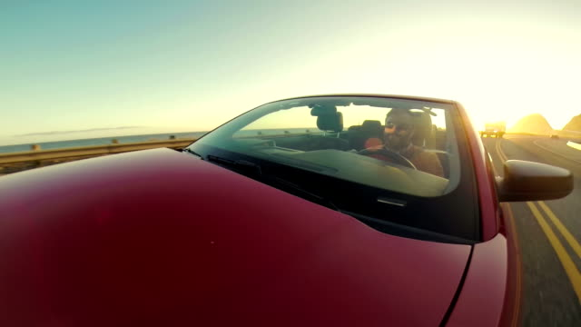 WS POV Man Driving Convertible Along The Coast