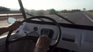 POV man driving old car at highway