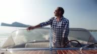 Man driving on yacht