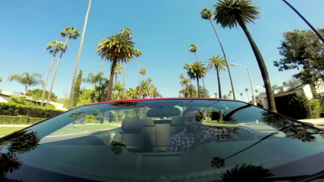WS POV Man Driving Through Beverly Hills