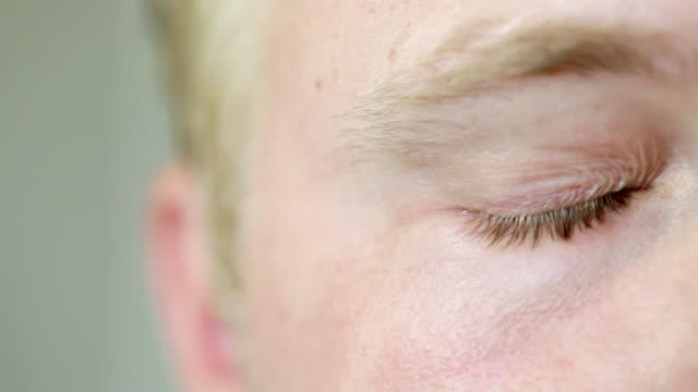Man drying his eyes, close up