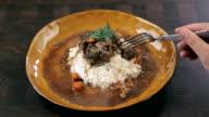 POV man eating stew