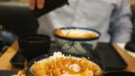 man eats Japanese food