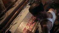 MS HA Man embroidering sari with gold thread / India