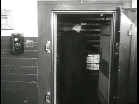 A man enters a vault in Fort Knox and looks at a gold bar