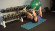 'MS Man exercising abs with yoga ball / Beverly Hills, California, United States'