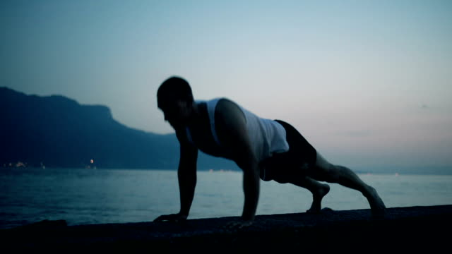 Man exercising push ups silhouette