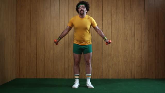 WS Man exercising with dumbbells and falling, Atlanta, Georgia, USA