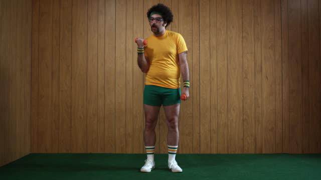 WS Man exercising with dumbbells, Atlanta, Georgia, USA