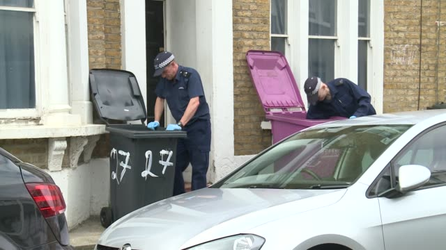 London Bow EXT Police officers in cordonedoff street / Vox pop/ Police officers searching bins Police forensic officer in cordonedoff street/...