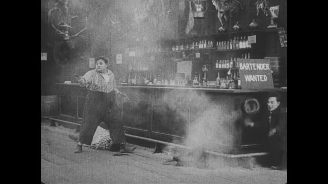 Fatty Arbuckle fends off the bandits by wielding two guns