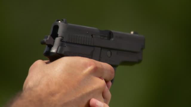 CU Man firing 44 caliber handgun, Stowe, Vermont, USA