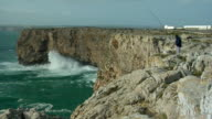 WS, Man fishing from cliff, Sagres Point, Faro, Portugal