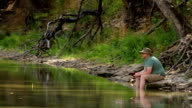 Man Fishing From River Bank HD