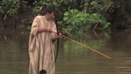 MS man fishing with bow and arrow/ Manu National Park, Peru