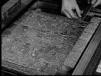 1955 FILM MONTAGE CU Man fitting text advertisements on metal newspaper printing block. MS Man cutting metal strip/ CU Man arranging text/ Buffalo, New York