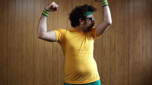 MS Man flexing muscles, Atlanta, Georgia, USA