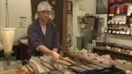 MS Man flipping griddles, Nishiki Market, Kyoto, Japan