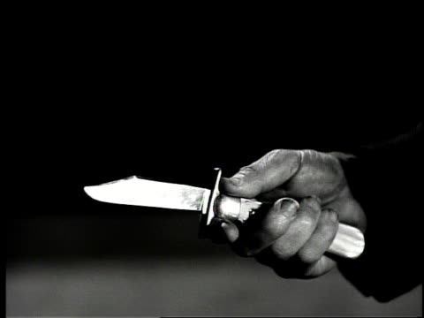 Man flipping open switchblade