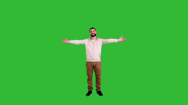 Man gesturing welcoming sign on green screen background