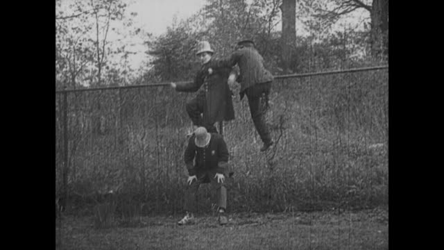 Buster Keaton gets caught on a fence