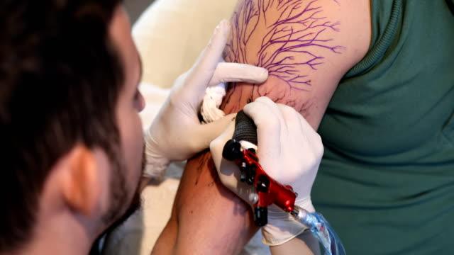 Man getting a tattoo 4k