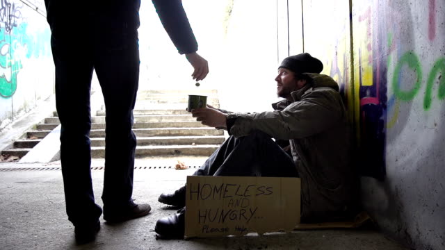 HD SUPER SLOW-MO: Man Giving Coins To A Homeless Person