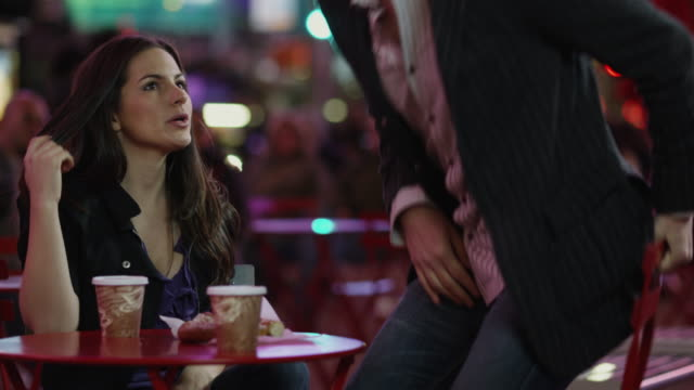 SLO MO MS Man giving engagement ring to woman in Times Square at night / New York City, New York State, USA