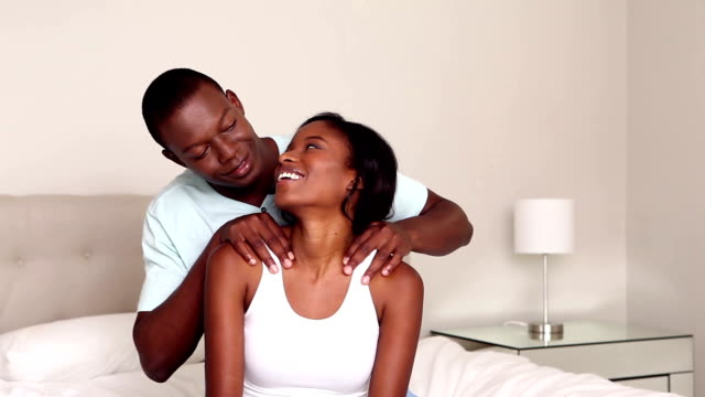Man giving his pretty girlfriend a massage