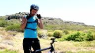 Man going cycling putting helmet on