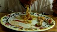 Man greedy eating spaghetti