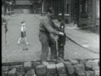 Man hammering cobbles into a cobbled street