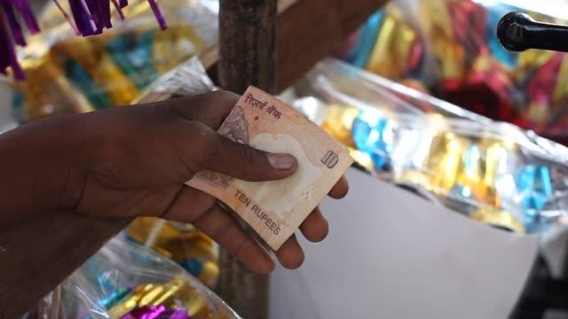 man handles currency in Mumbai Mumbai Currency on November 12 2012 in Mumbai India