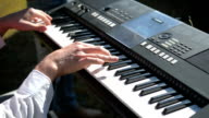 Man hands playing on the keyboard