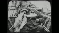 Fatty Arbuckle has scary time on water ride with date, falls off ride and into water