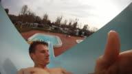 HD SLOW MOTION: Man Having Fun On A Waterslide