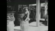 Buster Keaton hides in garbage barrel to gain free entrance into Coney Island